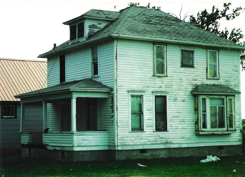 The original house before a coat of paint.